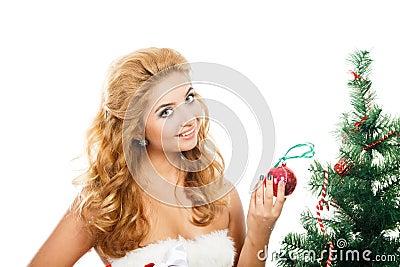 Beautiful girl holding christmas toy isolated white background Stock Photo
