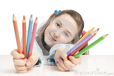 Beautiful girl holding color pencils