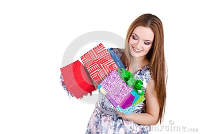 Beautiful girl holding gifts isolated