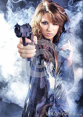 Free Beautiful Girl Holding Gun Royalty Free Stock Images - 9497429