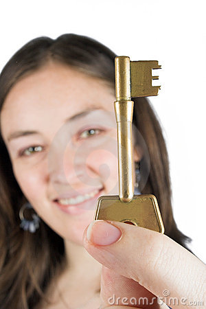 Beautiful girl holding key of success