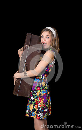 Beautiful girl holding old suitcase and shouting