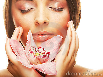 Beautiful girl holding orchid flower