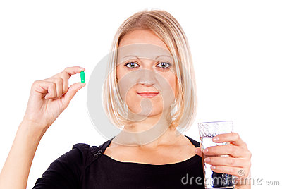 Beautiful girl holds pill
