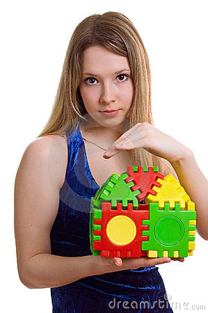 Beautiful girl holds the toy house