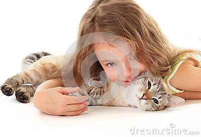 Beautiful girl hugging her cat.