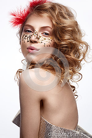 Free Beautiful Girl In A Gold Dress With A Gentle Make-up. Model With Red Feathers On Her Head And Curls. Holiday Photo. Stock Image - 83889941