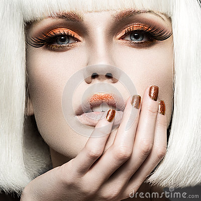 Free Beautiful Girl In A White Wig, With Gold Makeup And Nails. Celebratory Image. Beauty Face. Royalty Free Stock Photo - 51659005