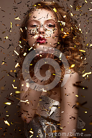 Free Beautiful Girl In An Evening Dress And Gold Curls. Model In New Year`s Image With Glitter And Tinsel. Royalty Free Stock Photo - 83474175