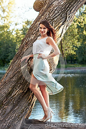 Free Beautiful Girl In Elegant Dress And Charming Smile Posing For The Photographer In The Park Of Yekaterinburg Stock Photography - 81845602