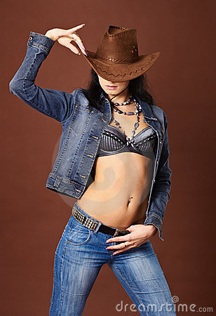 Free Beautiful Girl In Jeans And Cowboy Hat Stock Image - 19227441