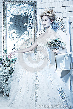 Free Beautiful Girl In White Dress In The Image Of The Snow Queen With A Crown On Her Head. Royalty Free Stock Photo - 47633985