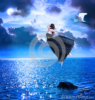 Free Beautiful Girl Jumping Into The Blue Night Sky Royalty Free Stock Photography - 24731727