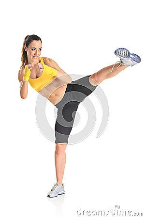 Beautiful girl kicking with the leg