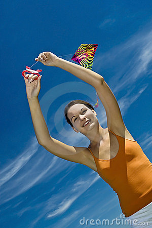 Beautiful girl kite fly.