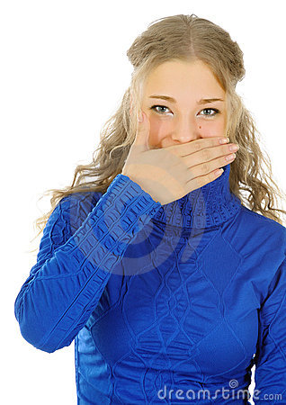 Beautiful girl laughs into her hand.