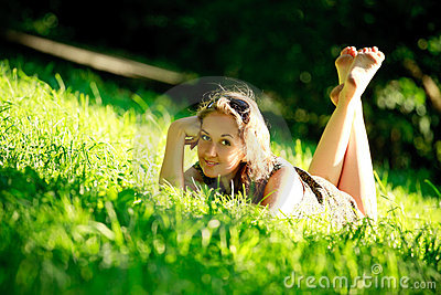 Beautiful Girl Laying On Sunny Meadow Stock Image - Image: 15242371