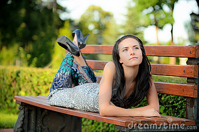 Beautiful girl lies in park