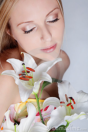 Beautiful girl with lily flower