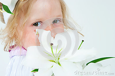 Beautiful girl with a lily flower