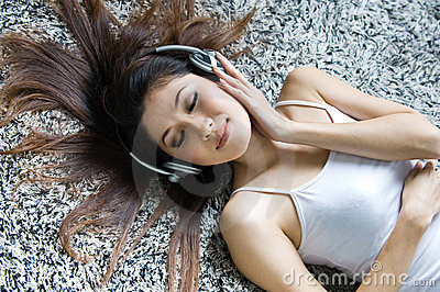 Beautiful girl listening music