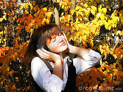 Beautiful girl listening to music  in earphone