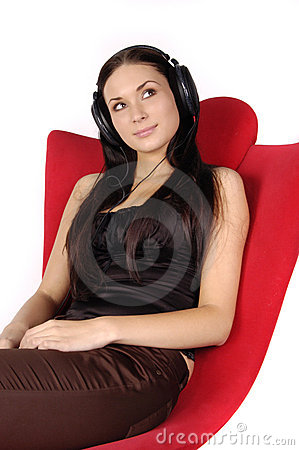 Beautiful girl listens to music in headphones