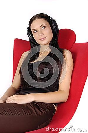 Beautiful girl listens to music in headphones