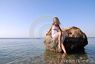 Beautiful girl looking far away