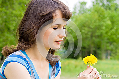 Beautiful girl looking at the flowers