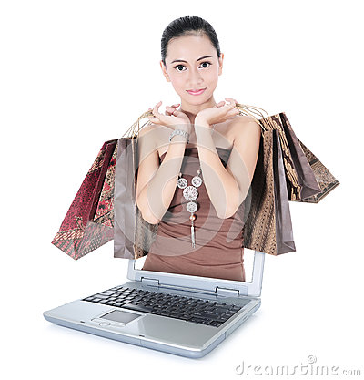 Beautiful girl with lots of shopping bags out of the laptop