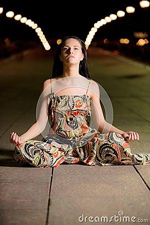 Beautiful girl in lotus pose
