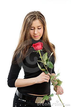 Beautiful girl in love holding a red rose