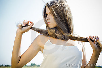 Beautiful girl with luxuriant hair