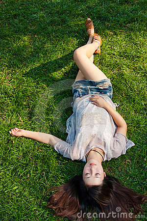 Free Beautiful Girl Lying Down At Grass Royalty Free Stock Photos - 21457468