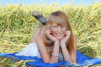 Beautiful girl lying in the field