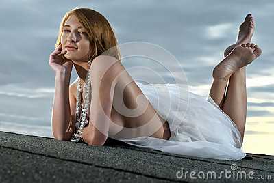 Beautiful girl lying on the roof