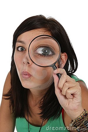 beautiful girl with magnifying glass royalty free stock
