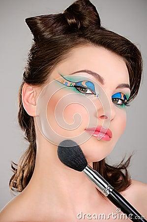 Beautiful girl makes a makeup