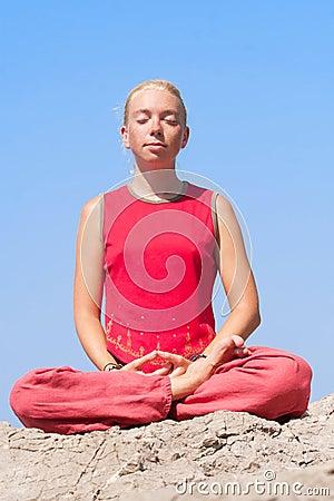 Beautiful girl making yoga exercise