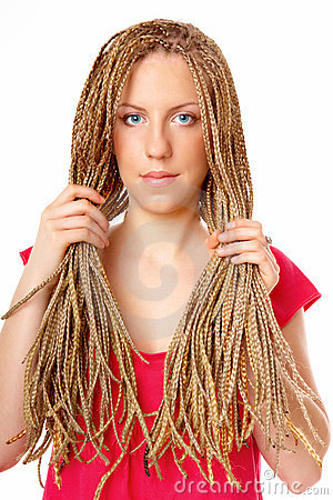 Beautiful girl many plaits hairstyle holding hair