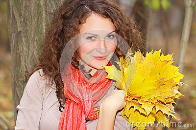 Beautiful girl with maple leaves