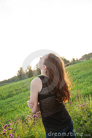 Beautiful girl in the meadow
