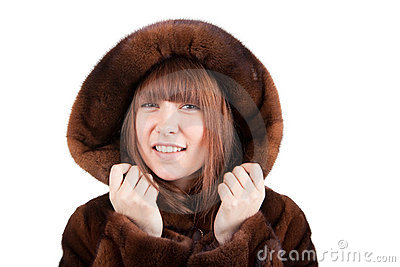 The beautiful girl in a mink fur coat