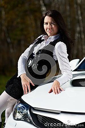 Beautiful girl model and stylish white sports car