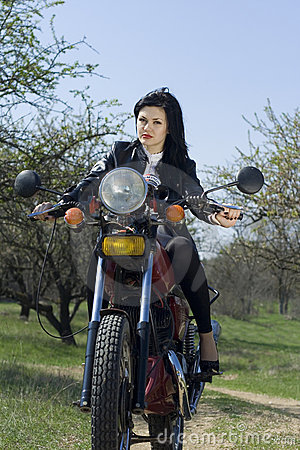 The beautiful girl on a motorcycle
