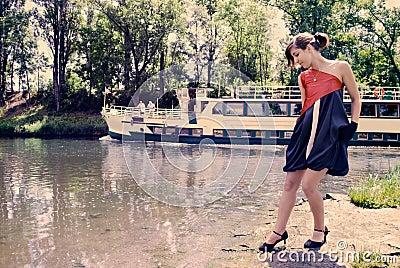 Beautiful girl near the river