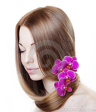 Beautiful girl with orchids in her gorgeous hair