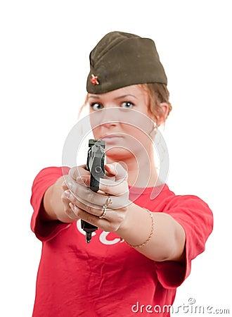 Beautiful girl in overseas cap holding gun.