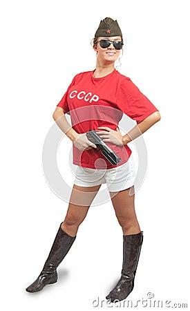 Beautiful girl in overseas cap holding gun